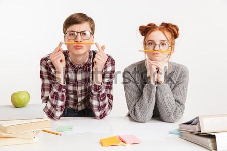 Mutlu çift okul kitaplar oturma Stok fotoğraf © deandrobot