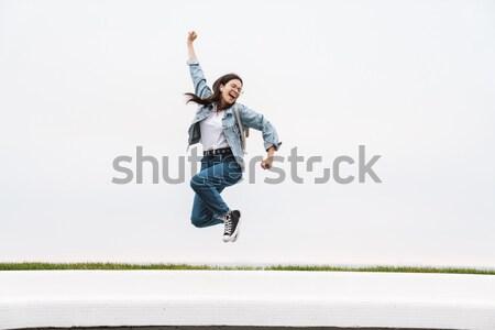 Funny man posing over white background Stock photo © deandrobot