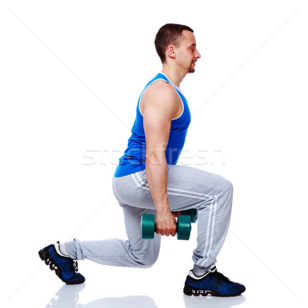 Sport man working out with dumbbells over white bakground Stock photo © deandrobot