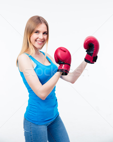 Smiling woman in boxing gloves Stock photo © deandrobot
