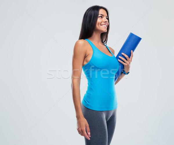 Spor kadın yoga mat gri Stok fotoğraf © deandrobot