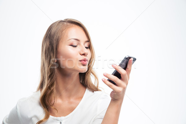 Girl doing video call with smartphone Stock photo © deandrobot