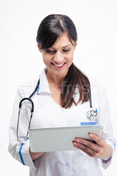 Medical doctor using tablet computer Stock photo © deandrobot