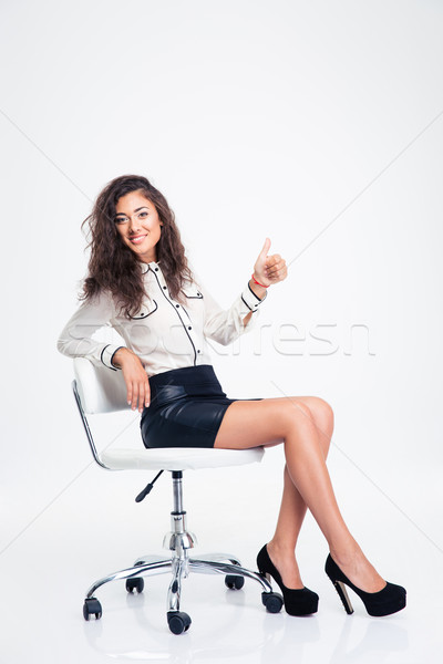 Femme d'affaires séance chaise de bureau pouce up Photo stock © deandrobot