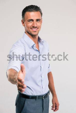 Businessman stretching hand for handshaking Stock photo © deandrobot