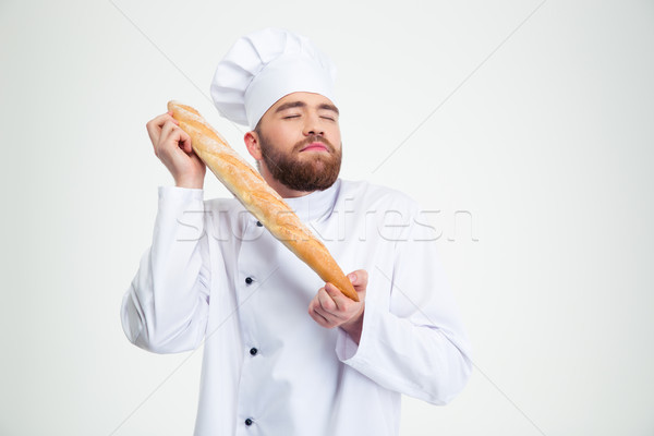 Portrait of male chef cook holding fresh bread Stock photo © deandrobot