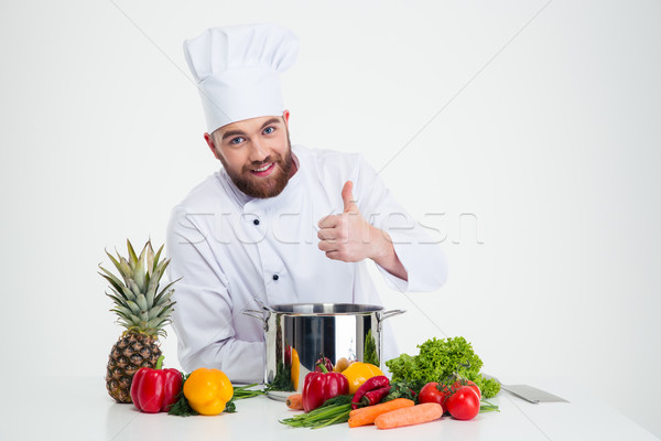 Male chef cook preparing food and showing thumb up  Stock photo © deandrobot