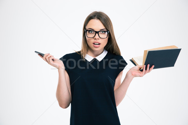 Woman holding book and smartphone Stock photo © deandrobot