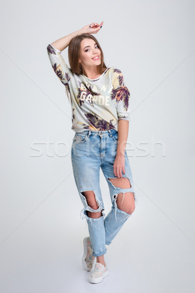 Full length portrait of a smiling hipster woman Stock photo © deandrobot