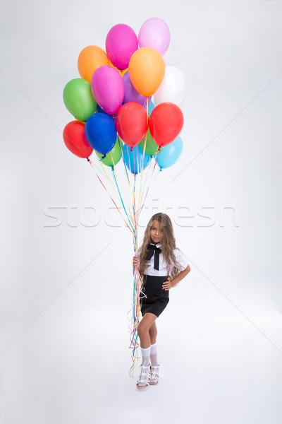 Aranyos kicsi iskolás lány áll léggömbök teljes alakos Stock fotó © deandrobot