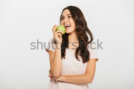 Stock photo: Happy beautiful woman eating apple