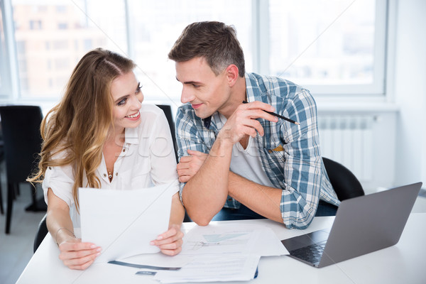 Cheerful man and woman flirting on business meeting  Stock photo © deandrobot