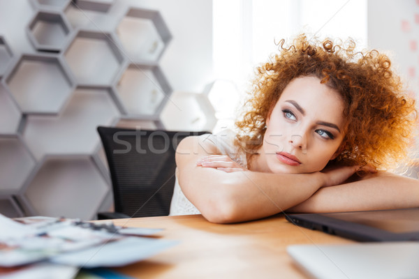 Attractive thoughtful woman designer sitting and dreaming on workplace Stock photo © deandrobot
