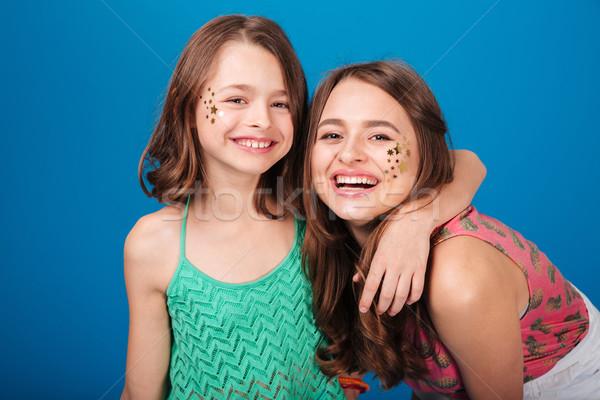 Due felice sorelle decorazioni guance ridere Foto d'archivio © deandrobot