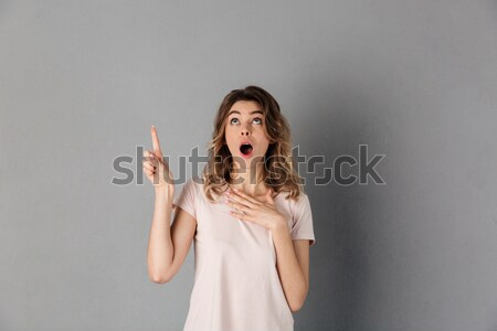 Cute playful redhead young woman winking and showing ok sign Stock photo © deandrobot