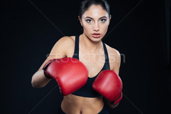 Fitnessz lány boxkesztyűk harcol fekete mosoly Stock fotó © deandrobot