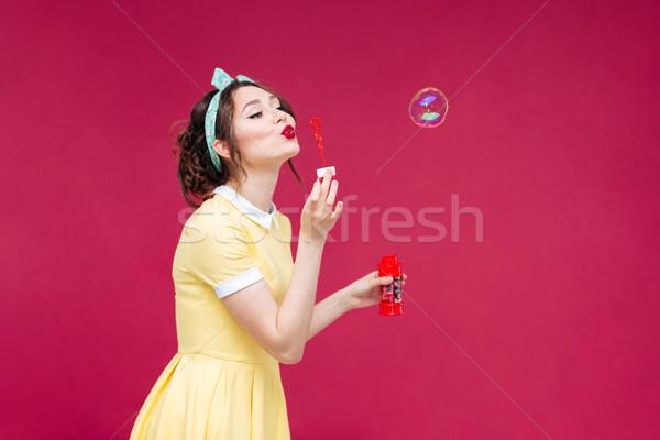 Bájos nő citromsárga ruha áll fúj Stock fotó © deandrobot