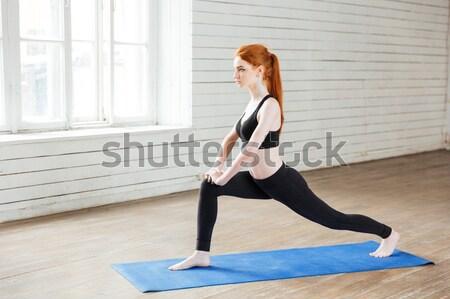 Fiatal gyönyörű nő ül jóga pozició tornaterem Stock fotó © deandrobot