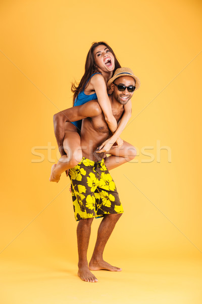 Loving smiling couple in swimwear having fun Stock photo © deandrobot