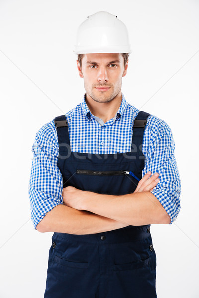 Serious man foreman in hard hat standing with handsom folded Stock photo © deandrobot