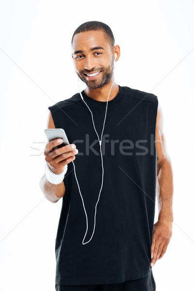 молодые спортсмена сотового телефона портрет Сток-фото © deandrobot
