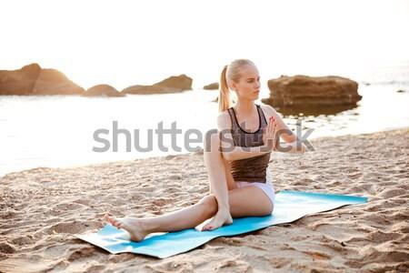 Portre genç kadın yoga mat açık havada plaj Stok fotoğraf © deandrobot