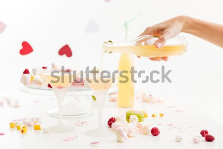 Table with sweets and lemonade ready for celebration Stock photo © deandrobot