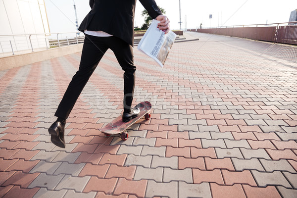 Close up businessman on skate Stock photo © deandrobot