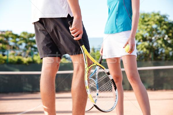 Legs of tennis couple Stock photo © deandrobot