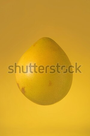 Pomelo isolated on yellow background Stock photo © deandrobot