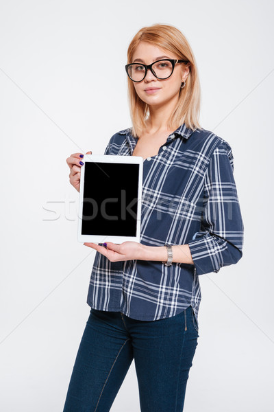 Attractive young woman showing display to camera Stock photo © deandrobot