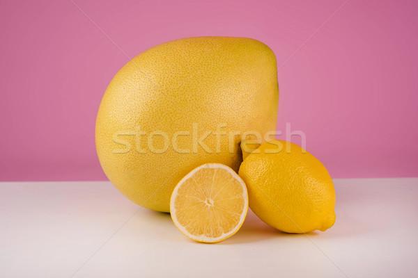 Mixed citrus fruit including lemon and pomelo Stock photo © deandrobot
