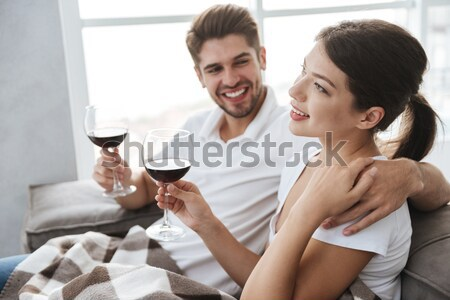 Sensual couple hugging and drinking red wine on the kitchen Stock photo © deandrobot