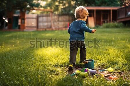 Bastante menino recreio grama criança diversão Foto stock © deandrobot