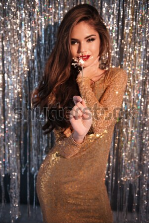 Happy woman in evening dress standing and showing her award Stock photo © deandrobot