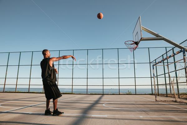 Basketball player scoring a point Stock photo © deandrobot