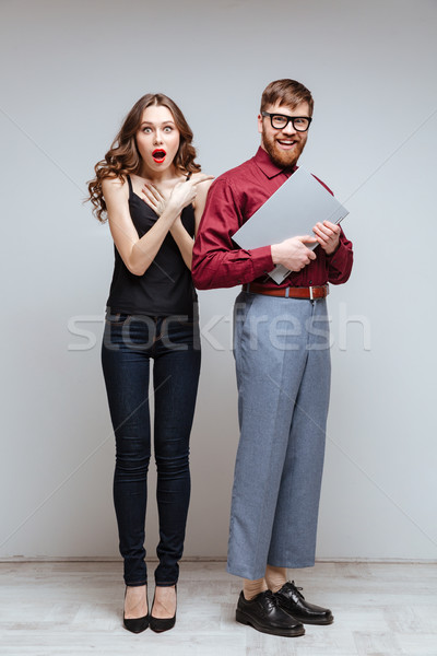 Stock photo: Vertical image of Surprised woman with Male nerd