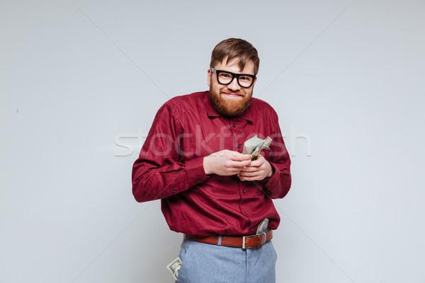 Komik erkek inek öğrenci para el gözlük Stok fotoğraf © deandrobot