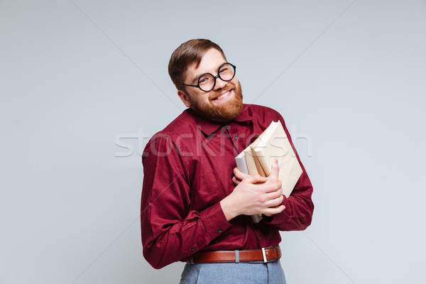 Masculino nerd livros mãos olhando câmera Foto stock © deandrobot