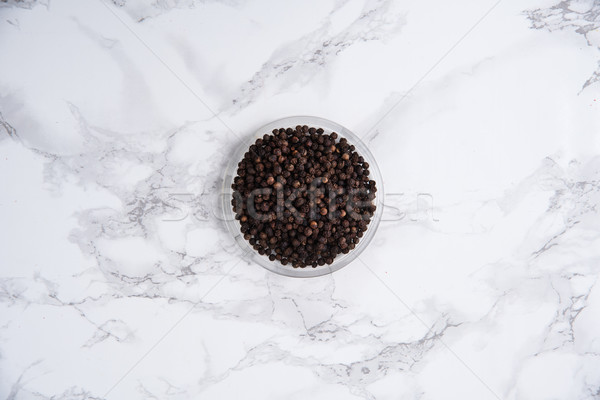 Black pepper in a bowl on white marble Stock photo © deandrobot