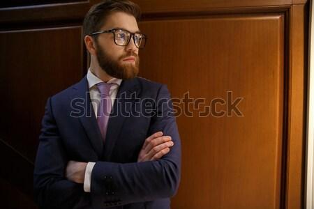 Konsantre sakallı genç işadamı görüntü Stok fotoğraf © deandrobot