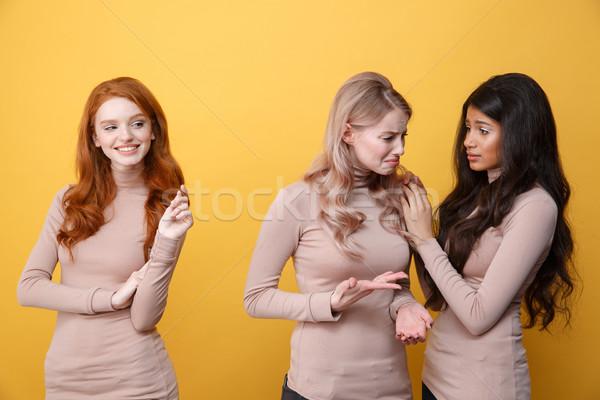 Happy redhead lady looking at african lady calms woman friend Stock photo © deandrobot