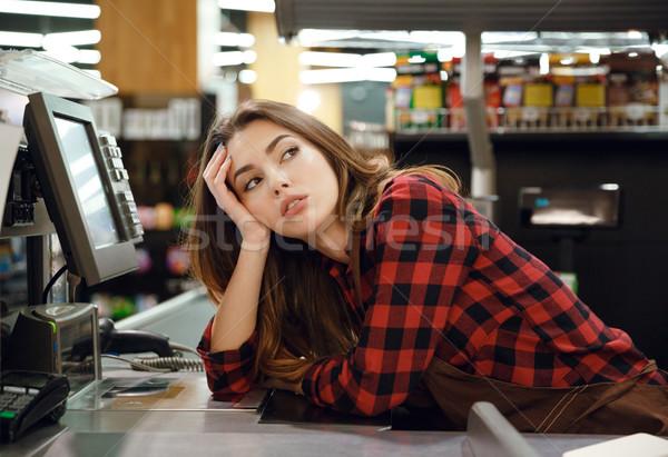 Fáradt pénztáros hölgy hazugságok munkaterület áruház Stock fotó © deandrobot