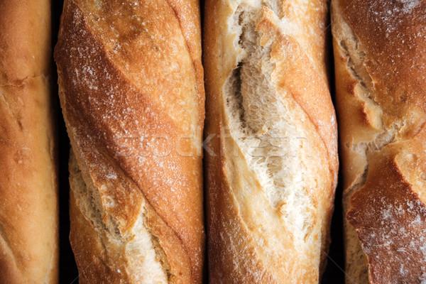 Bread loafs at bakery Stock photo © deandrobot