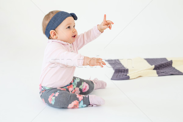 Pretty girl sitting on floor with plaid isolated Stock photo © deandrobot
