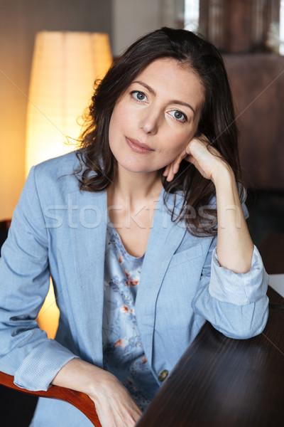Elképesztő nő ül bent asztal kép Stock fotó © deandrobot