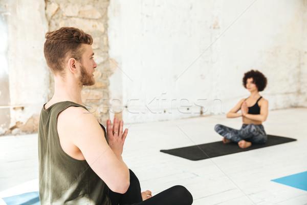 Trener jogi klasy studentów studio człowiek Zdjęcia stock © deandrobot