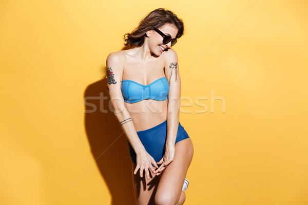 Happy young woman in swimwear isolated Stock photo © deandrobot