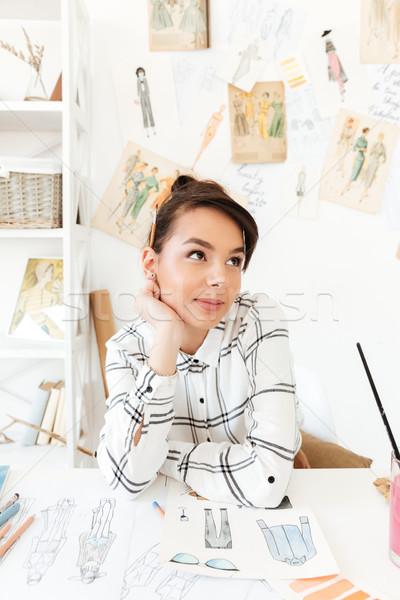 Pretty thinking woman fashion illustrator drawing Stock photo © deandrobot