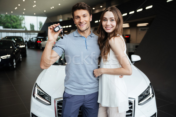 Happy young woman standing near car with boyfriend Stock photo © deandrobot